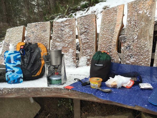 Lunch stop Alpkit titanium mug, folding titaniun spoon and Kraku stove